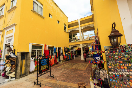 COZUMEL MEXICO JAN 26 2016:Colorful souvenir, coffee shops located in town. Tourists can buy various souvenirs as a memory about beautiful Tropical Island. The economy of Cozumel is based on tourism. Sajtókép