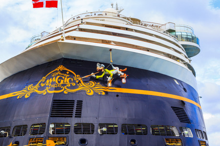 embark: COZUMEL, MEXICO - JAN 26 2016: NCL Dawn & Disney Magic at Cozumel port. Over 6500 passengers visited that beautiful tropical island. The economy of Cozumel is based on tourism. Editorial