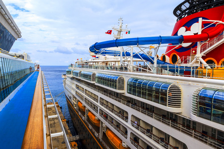 cozumel: COZUMEL, MEXICO - JAN 26 2016: NCL Dawn & Disney Magic at Cozumel port. Over 6500 passengers visited that beautiful tropical island. The economy of Cozumel is based on tourism. Editorial