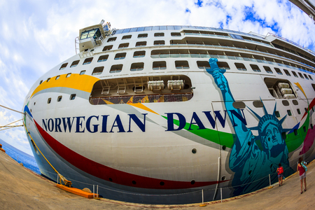 cozumel: COZUMEL, MEXICO - JAN 26 2016: NCL Dawn at Cozumel port. Over 3,500 passengers visited that beautiful tropical island. The economy of Cozumel is based on tourism.