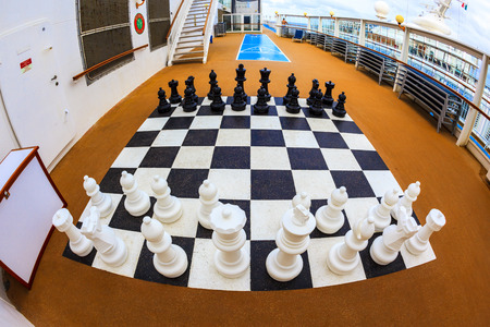 sip: ON BOARD OF CRUISE SIP N.C.L. DAWN JAN 26 2016: Chessboard and chess pieces on the deck