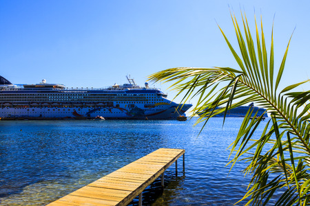 vacationers: ROATAN ILAND HONDURAS JAN 28 2016:Ctruise ships docked near the bay at Coxen Hole, Roatan Town, with a population of 5,070, Favorite spot for cruise ships and tropical lover vacationers