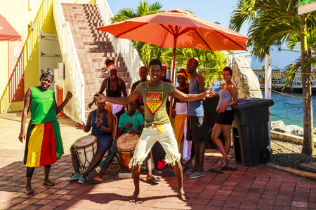 tourists stop: ROATAN ISLAND, HONDURAS - JAN 28 2016 : Indigenous islander performed traditional dance to welcome tourists  in Roatan Island, Honduras. Roatan Island is a favorite stop for cruise lines. Editorial