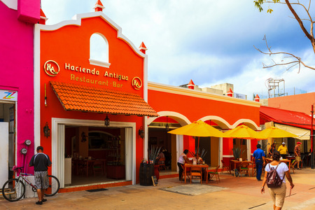 cozumel: COZUMEL MEXICO JAN 26 2016:Colorful souvenir, coffee shops located in town. Tourists can buy various souvenirs as a memory about beautiful Tropical Island. The economy of Cozumel is based on tourism. Editorial