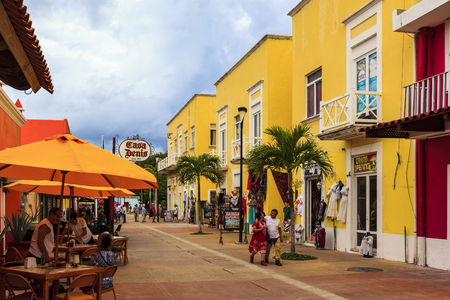 island paradise: COZUMEL MEXICO JAN 26 2016:Colorful souvenir, coffee shops located in town. Tourists can buy various souvenirs as a memory about beautiful Tropical Island. The economy of Cozumel is based on tourism. Editorial