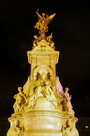 The Victoria Memorial at night, is a sculpture dedicated to Queen Victoria, sculpted by Sir Thomas Brock in London, placed at the center of Queens Gardens in front of Buckingham Palace.