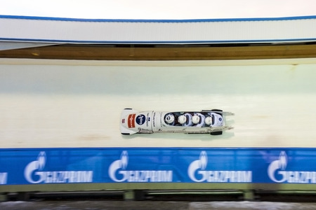luge: CALGARY CANADA - DEC 21  2014 :  Bobsleigh and Skeleton World Cup on February 16, 2013 in Sochi, Russia. Center Luge Sanki. Team Canada on track.