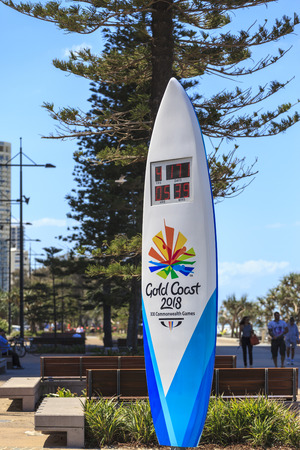SURFERS PARADISE-OCTOBER 15: The 2018 Commonwealth Games countdown clock shaped as a surfboard is four meters tall and stands at the beach end of Cavill Ave. Oct 15, 2013 Surfers Paradise, Australia