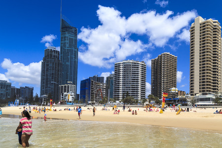 newer: GOLD COAST, AUSTRALIA - APRIL 6 2014 : Thousands of tourists are enjoying the glories weather and wonderful beaches at Surfers Paradise where the summer newer ends 2014 Gold Coast Australia