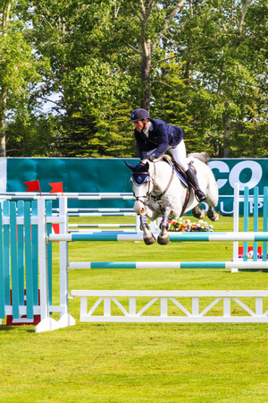 CALGARY CANADA - JUN 7 2015   Unidentified rider in action during the prestige s Spruce Meadows International hors jumping competition,  riders comes all over the world to compete. Editorial