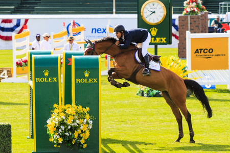 snob: CALGARY CANADA - JUN 7 2015   Unidentified rider in action during the prestige s Spruce Meadows International hors jumping competition,  riders comes all over the world to compete. Editorial