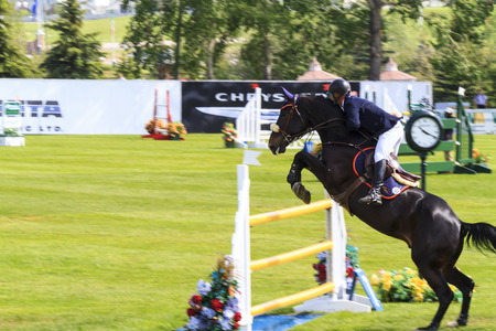 prestige: CALGARY CANADA - JUN 7 2015   Unidentified rider in action during the prestige s Spruce Meadows International hors jumping competition,  riders comes all over the world to compete. Editorial