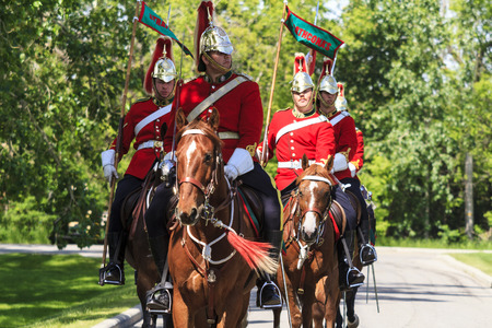 mounted: CALGARY CANADA - JUNE 6, 2015: The Royal Canadian Mounted Police (RCMP) Musical Ride performs in Calgary in Horseman Guards Uniform.