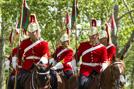 mountie: CALGARY CANADA - JUNE 6, 2015: The Royal Canadian Mounted Police (RCMP) Musical Ride performs in Calgary in Horseman Guards Uniform.