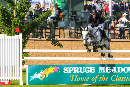 CALGARY CANADA - JUN 7 2015 :  Spruce Meadows International hors jumping competition, � Stock Photo #77782566 CALGARY CANADA - JUN 7 2015 Unidentified rider in action during the prestige s Spruce Meadows International hors jumping competition, ride Editorial