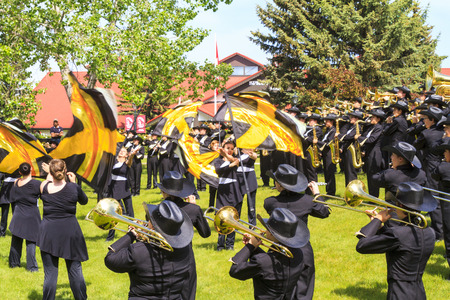 entertainers: CALGARY CANADA - JUN 7 2015  The Calgary Round-Up Band  Entertainers  during the prestige s Spruce Meadows International hors jumping competition,  riders and visitors are comes all over the world to compete.