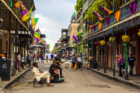 NEW ORLEANS, LOUISIANA USA- FEB 2 2016: An unidentified local jazz band performs in the New Orleans French Quarter on, to the delight of visitors in town Editorial