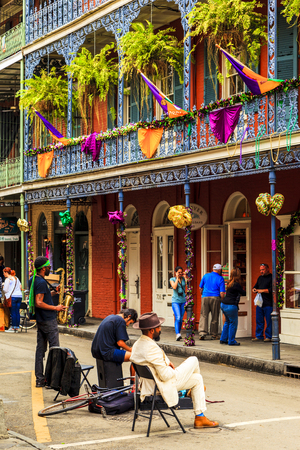 NEW ORLEANS, LOUISIANA USA- FEB 2 2016: An unidentified local jazz band performs in the New Orleans French Quarter on, to the delight of visitors in town Sajtókép