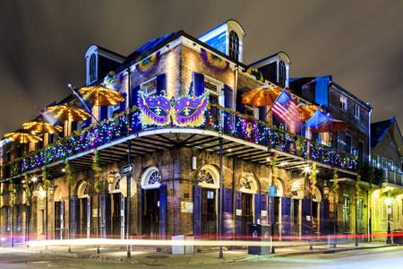 NEW ORLEANS, LOUISIANA USA- JAN 23 2016: Pubs and Bars having colorful lights and decorations in the French Quarter. Tourism provides a much needed financial source, also home for great musicians. 新闻类图片