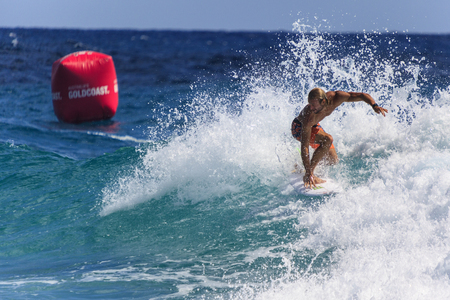 gold coast australia: SNAPPER ROCKS, GOLD COAST, AUSTRALIA - MARCH 2, Unidentified Surfer races the Quiksilver & Roxy Pro World Title Event. March 2, 2014, Snapper Rocks, Gold Coast, Australia