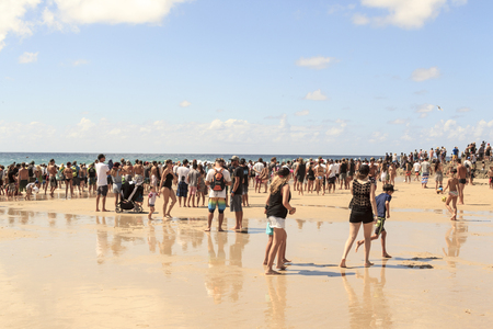 quicksilver: SNAPPER ROCKS, GOLD COAST, AUSTRALIA - 9 MARCH: Spectators on the beach waiting to start the Quicksilver & Roxy Pro World Title Event. 9 March 2014, Snapper Rocks, Gold Coast, Australia