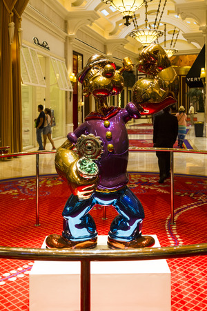 million dollars: LAS VEGAS, NEVADA, USA - JULY 12, 2015 : The Jeff Koons Popeye Sculpture display at the Wynn Hotel in Las Vegas. The sculpture purchased by Steve Wynn in May 2014 for $28.1 million dollars