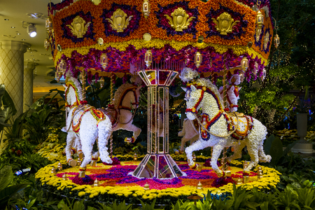 nv: LAS VEGAS - JUN  24, 2015 : Flowers installation at the Wynn Hotel and casino  in Las Vegas. The installation made of 110,000 flowers and designed by Preston Bailey Editorial