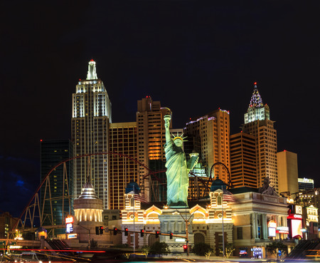 new york strip: LAS VEGAS - JULY 8 2015: New York-New York located on the Las Vegas Strip is shown in Las Vegas. Replica of the Statue of Liberty is 150 ft (46 m) and the property opened in 1997.