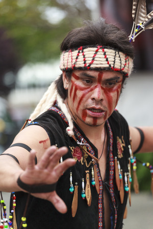 VICTORIA CANADA JUN 18 2016: First Nation (Native) dancers performing at the Victoria Aboriginal Cultural Festival. Spectacular performances at the Royal BC Museum in the heart of downtown Victoria.