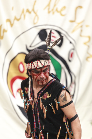 ceremonial clothing: VICTORIA CANADA JUN 18 2016: First Nation (Native) dancers performing at the Victoria Aboriginal Cultural Festival. Spectacular performances at the Royal BC Museum in the heart of downtown Victoria.