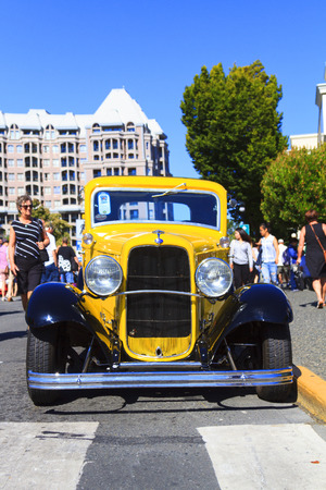 VICTORIA, BRITISH COLUMBIA - JULY 24, 2016: The largest collection of Deuces anywhere staged all around the beautiful Victoria Inner Harbor. Northwest Deuce Day is a sight to see!