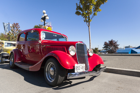 anywhere: VICTORIA, BRITISH COLUMBIA - JULY 24, 2016: The largest collection of Deuces anywhere staged all around the beautiful Victoria Inner Harbor. Northwest Deuce Day is a sight to see!