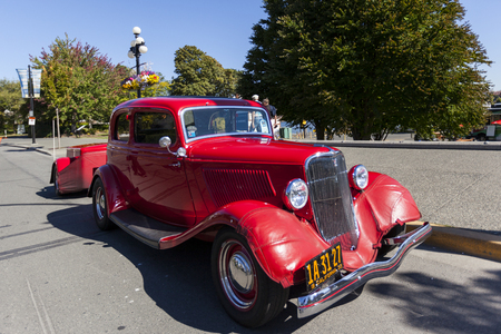 automobile door: VICTORIA, BRITISH COLUMBIA - JULY 24, 2016: The largest collection of Deuces anywhere staged all around the beautiful Victoria Inner Harbor. Northwest Deuce Day is a sight to see!