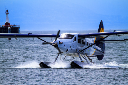 water turbine: VICTORIA, BC, CANADA - MAY 14 2016: Float-plane traffic in the inner harbor. This transportation is vital and very frequent between Vitoria and Vancouver, also the flight is very pictures.