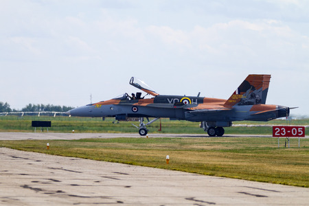 LETHBRIDGE CANADA - JUN 25, 2015: Royal Canadian Air Force CF-18 Hornet tactical fighter aircraft displaying flight agility at the Wing Over Lethbridge Airshow