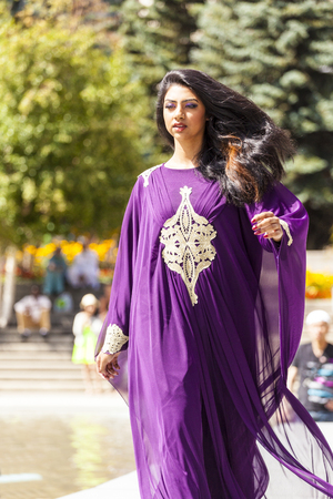 A The Calgary Festival of Fashion in Olympic Plaza 2014 Aug 20 :  Models walk the runway at woman fashion festival.