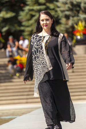 sleek: A The Calgary Festival of Fashion in Olympic Plaza 2014 Aug 20 :  Models walk the runway at woman fashion festival.