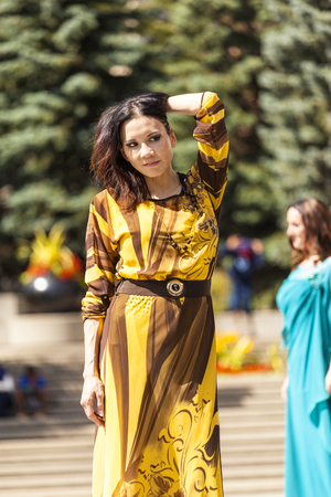 stage make up: A The Calgary Festival of Fashion in Olympic Plaza 2014 Aug 20 :  Models walk the runway at woman fashion festival.