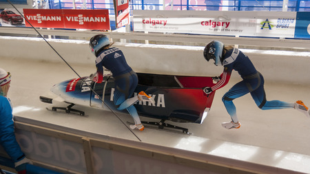 world cup: CALGARY CANADA, DEC 21 2014 : FIBT Viessmann Bobsleigh and Skeleton World Cup in Calgary Olympic Park.