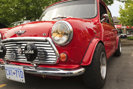 cooper: VICTORIA CANADA - JUNE 13, 2016: A Mini Cooper vintage car on display. The Mini is made by BMC and its successors from 1959 until 2000. The original is considered a British icon of the 1960s Editorial