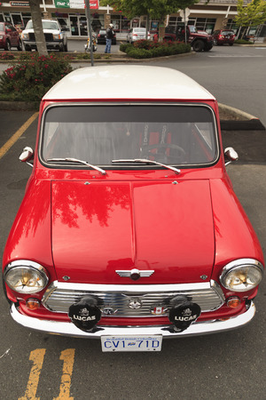 successors: VICTORIA CANADA - JUNE 13, 2016: A Mini Cooper vintage car on display. The Mini is made by BMC and its successors from 1959 until 2000. The original is considered a British icon of the 1960s Editorial