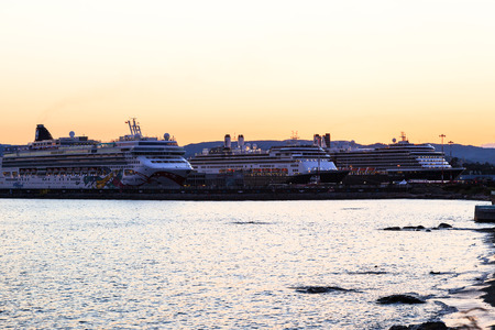 hundreds: VICTORIA, BC, CANADA - MAY 10 2016. Cruise ship at night in Victoria. Each year hundreds of cruise ships docks in for a day or a few hours. Ogden Point is also the place to see them come into port. Editorial