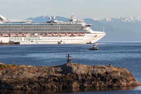 each year: VICTORIA, BC, CANADA - MAY 21 2016. Cruise ship in Victoria. Each year hundreds of cruise ships docks in for a day or two. Victorias charm and beauty has a lot to offer for any world traveler.
