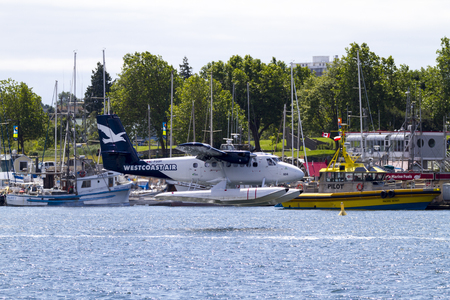 royals: VICTORIA, BC, CANADA - JUN 24 2016: Royals Victoria Float-plane in the inner harbor. This transportation is vital and very frequent between Vitoria and Vancouver, also the flight is very pictures.