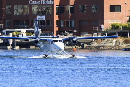 hydroplane: VICTORIA, BC, CANADA - JUN 24 2016: Royals Victoria Float-plane in the inner harbor. This transportation is vital and very frequent between Vitoria and Vancouver, also the flight is very pictures.
