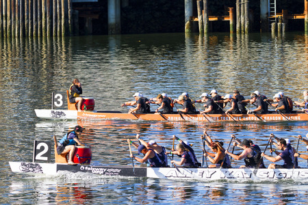 dragonboat: VICTORIA CANADA - AUG 14 2016: The annual  Victoria Dragon Boat Festival. Victoria's most spectacular summer festivals and the only dragon boat festival in Canada to take place in a working harbor. Editorial