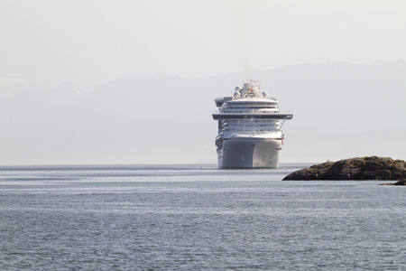 VICTORIA, BC, CANADA - JULY 21 2016. Cruise ship in Victoria. Each year hundreds of cruise ships docks in for a day or two. Victoria's charm and beauty has a lot to offer for any world traveler. Editöryel
