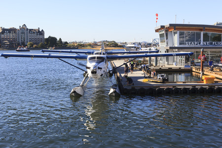 hydroplane: VICTORIA, BC, CANADA - JULY 24 2016: Float-plane traffic in the inner harbor. This transportation is vital and very frequent between Vitoria and Vancouver, also the flight is very pictures.