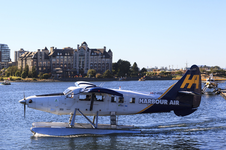 VICTORIA, BC, CANADA - JULY 24 2016: Float-plane traffic in the inner harbor. This transportation is vital and very frequent between Vitoria and Vancouver, also the flight is very pictures.