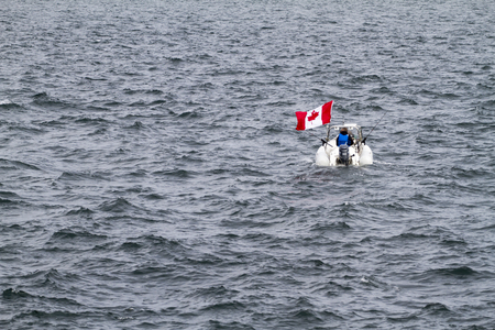 no mistake: VICTORIA, BC CANADA - JULY 29 2016: Two Canadian men fishing in open waters. No mistake they are from Canada. Editorial